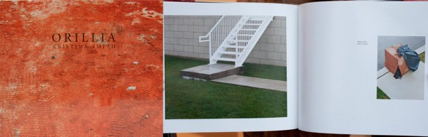 Hardcover book, abstract orange background with the title Orillia and Double page spread, urban scene of a sidewalk, lawn and metal staircase on the left, cardboard box and garbage bags on the right